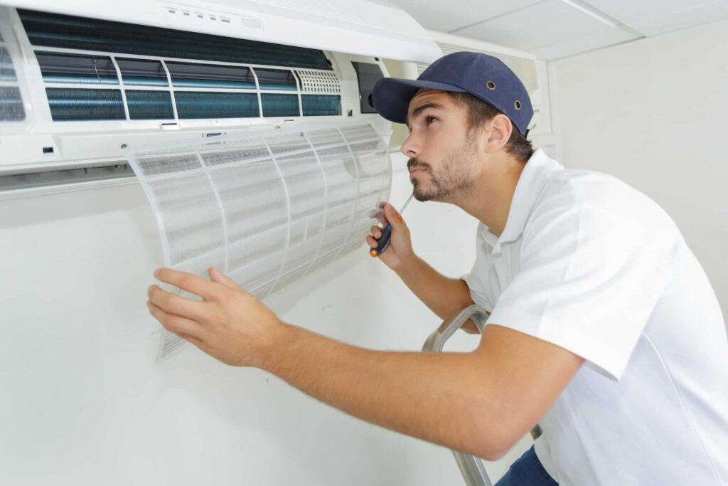Image of a man changing the AC filter